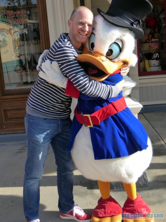 Hugging Scrooge McDuck in Disneyland Paris